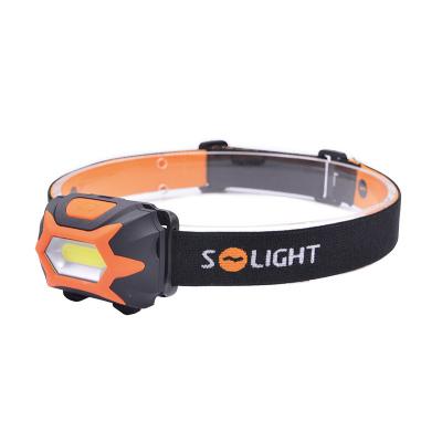 Levné Venkovní LED osvětlení: Solight čelová svítilna, COB LED, 3W, 150lm, 3x AAA, 3 režimy, oranžovočerná